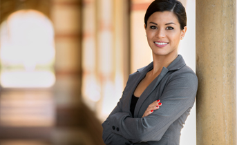business woman smiling with arms crossed